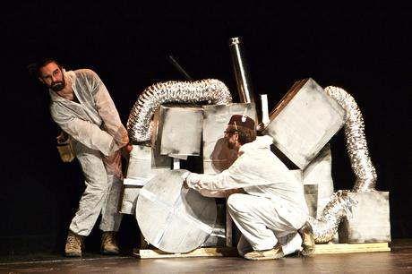 10-Minute Play Festival performance image of two actors and boxes on stage for the High Performance Rodeo