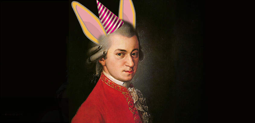 Portrait of Mozart with yellow rabbit ears and a stripped party hat on